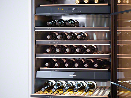Miele Built-in Wine Cooler filled with bottles of wine