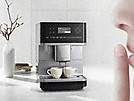 Miele Freestanding Countertop Coffee Machine with person holding an index finger in front of their mouth to indicate silence